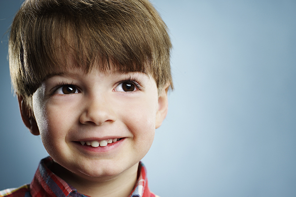 Janice Pliszczak dds dentist in syracuse NY smiling boy child in plaid shirt 83663439