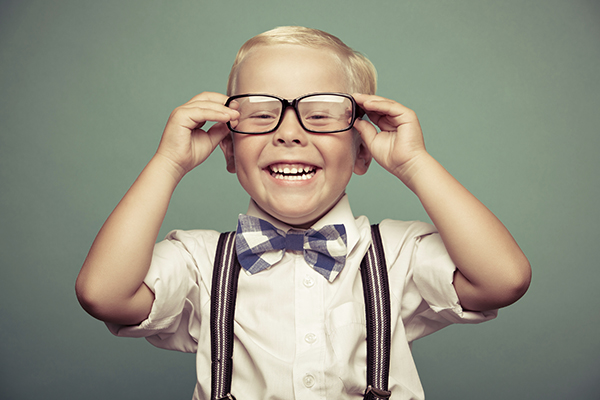 Little boy with glasses smiling after his parent's made an appointment at Janice K. Pliszczak, DDS in Syracuse, NY